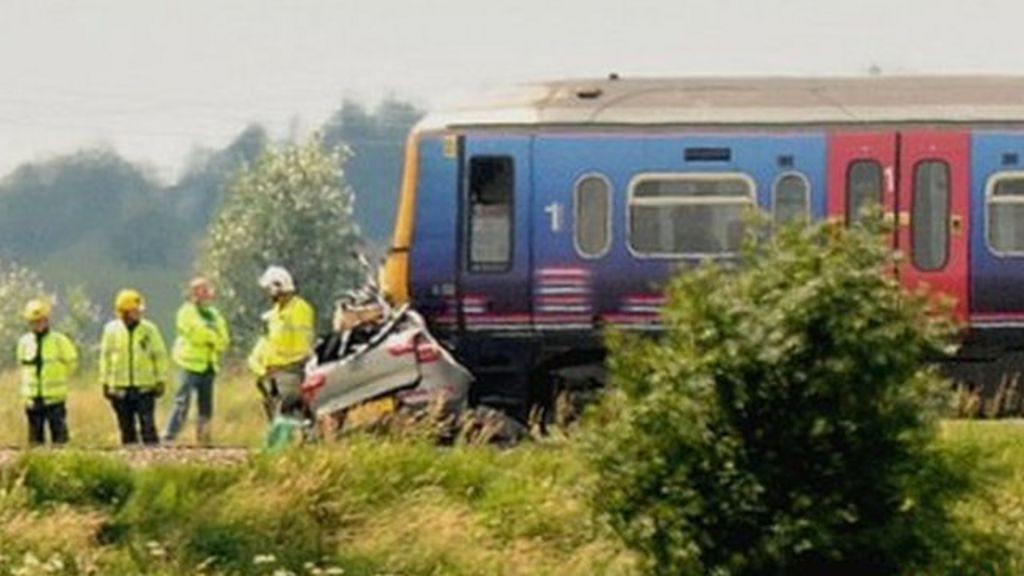 "Car under front of train following crash at ""user-worked"" crossing near Downham Market"