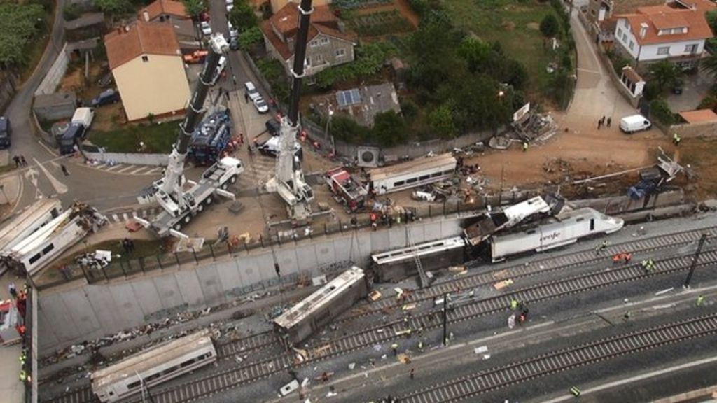 Rescue workers pull victims from train crash in north-western Spain on 24 July 2013