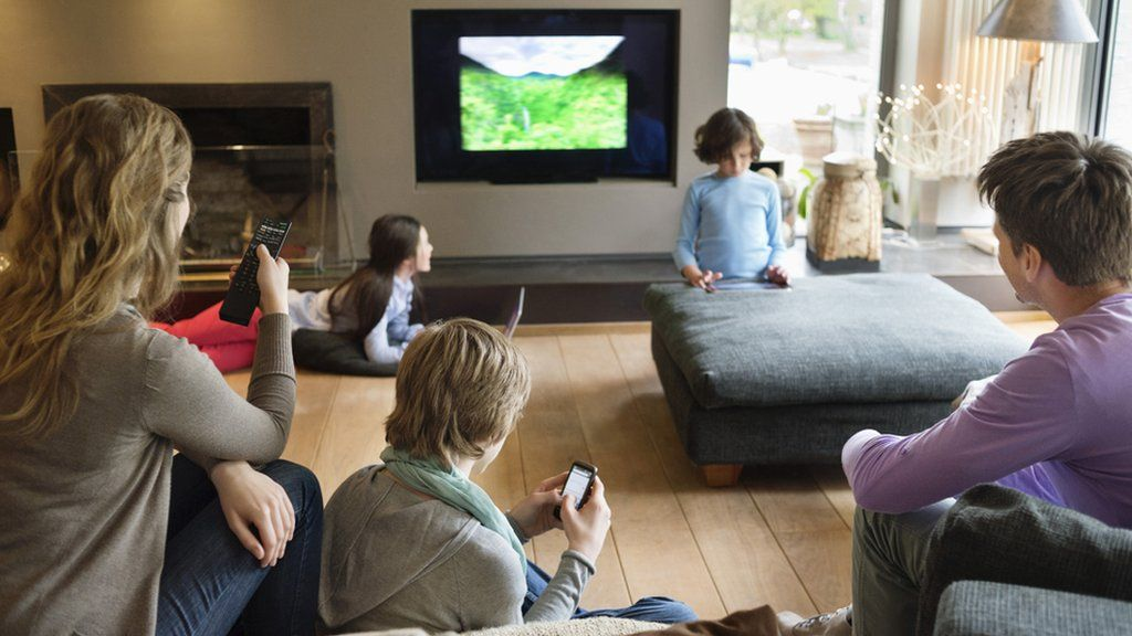 Mobile devices have brought families back into the living room to multitask  while watching TV