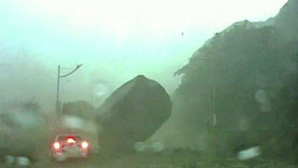 Taiwan Lucky Escape As Boulder Narrowly Misses Car BBC News - Huge boulder narrowly missed house in italy