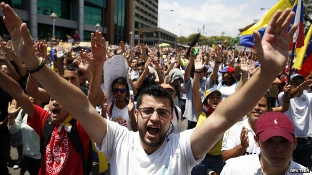 Venezuela protest photos: Police and protesters clash