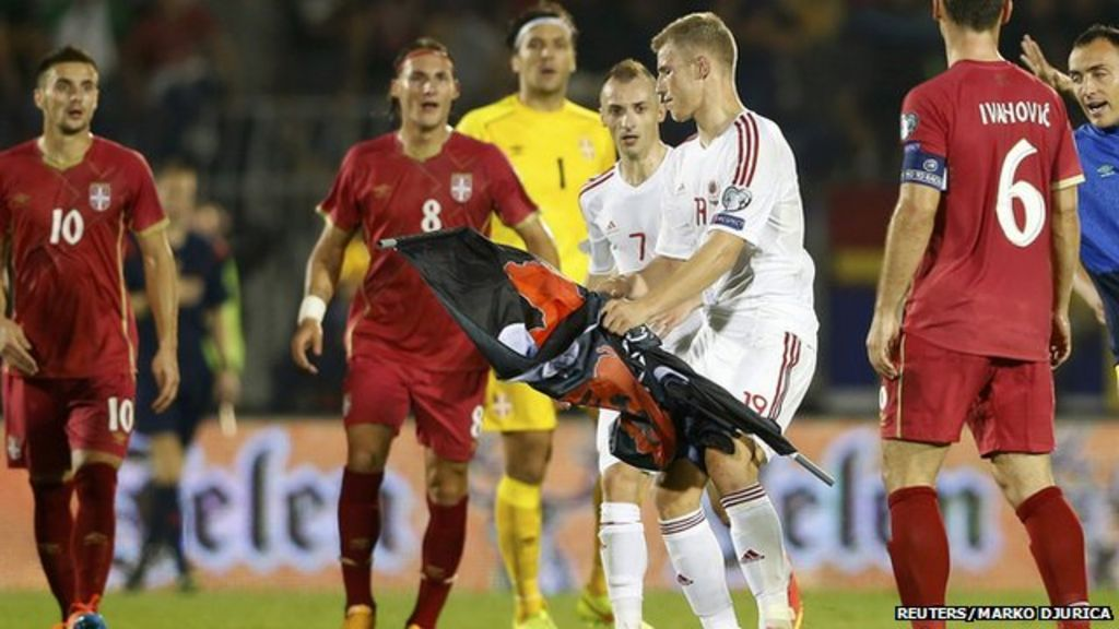 Riot police had to be brought in to restore calm but the Serbia-Albania  match was abandoned, as Wendy Urquhart reports