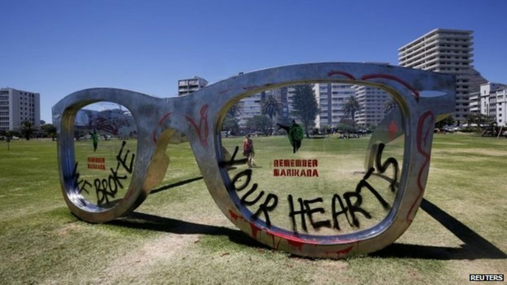 dc2eb67fa54 Mandela glasses sculpture defaced in South Africa - BBC News