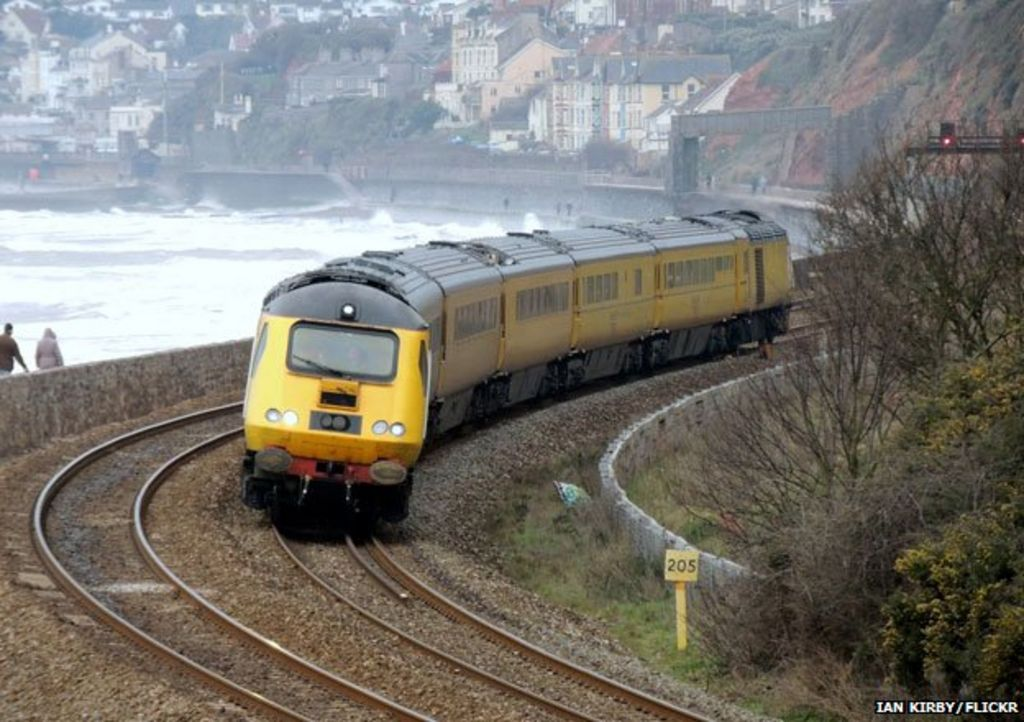 Train rounding bend outside Dawlish