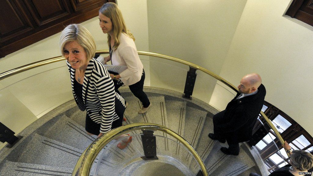 Alberta New Democratic Party (NDP) leader Rachel Notley (L) and her staff enter the Alberta Legislature Building via a spiral staircase for the first time as Premier-elect in Edmonton May 6, 2015.