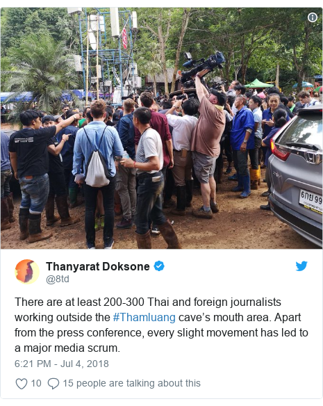 Twitter post by @8td: There are at least 200-300 Thai and foreign journalists working outside the #Thamluang cave's mouth area. Apart from the press conference, every slight movement has led to a major media scrum.