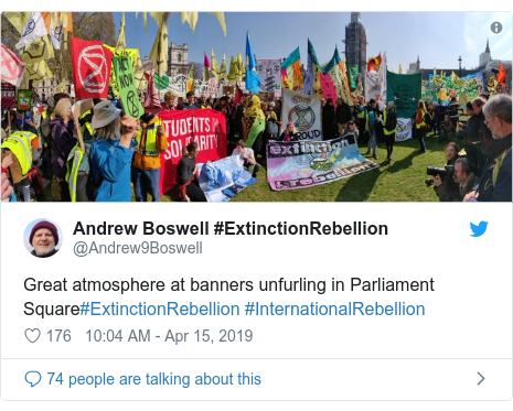 Twitter post by @Andrew9Boswell: Great atmosphere at banners unfurling in Parliament Square#ExtinctionRebellion #InternationalRebellion