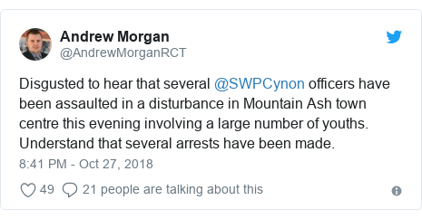 Twitter post by @AndrewMorganRCT: Disgusted to hear that several @SWPCynon officers have been assaulted in a disturbance in Mountain Ash town centre this evening involving a large number of youths. Understand that several arrests have been made.