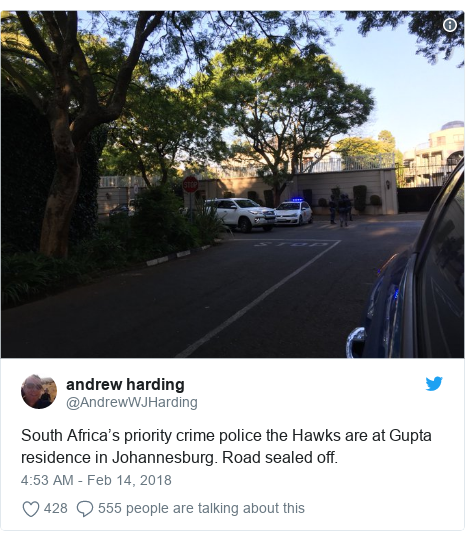 Twitter post by @AndrewWJHarding: South Africa's priority crime police the Hawks are at Gupta residence in Johannesburg. Road sealed off.