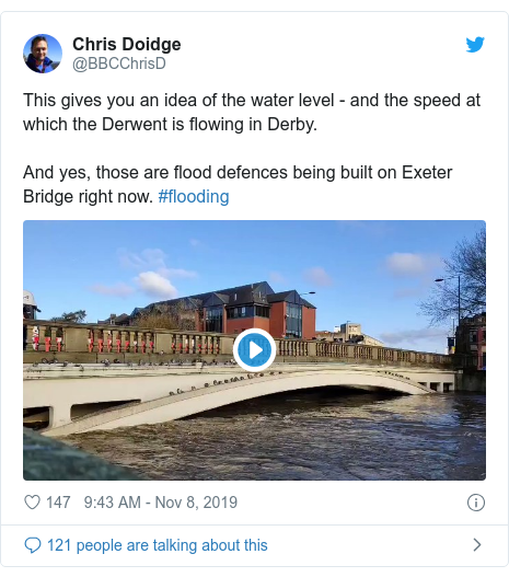 Twitter post by @BBCChrisD: This gives you an idea of the water level - and the speed at which the Derwent is flowing in Derby.And yes, those are flood defences being built on Exeter Bridge right now. #flooding