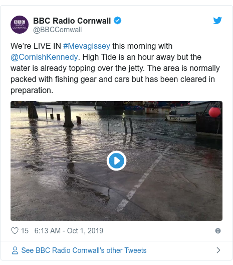 Twitter post by @BBCCornwall: We're LIVE IN #Mevagissey this morning with @CornishKennedy. High Tide is an hour away but the water is already topping over the jetty. The area is normally packed with fishing gear and cars but has been cleared in preparation.