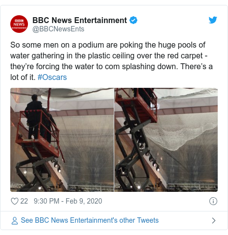 Twitter post by @BBCNewsEnts: So some men on a podium are poking the huge pools of water gathering in the plastic ceiling over the red carpet - they're forcing the water to com splashing down. There's a lot of it. #Oscars