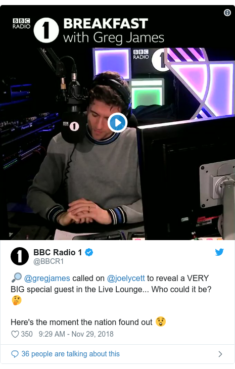 Twitter post by @BBCR1: 🔎 @gregjames called on @joelycett to reveal a VERY BIG special guest in the Live Lounge... Who could it be? 🤔Here's the moment the nation found out 😲