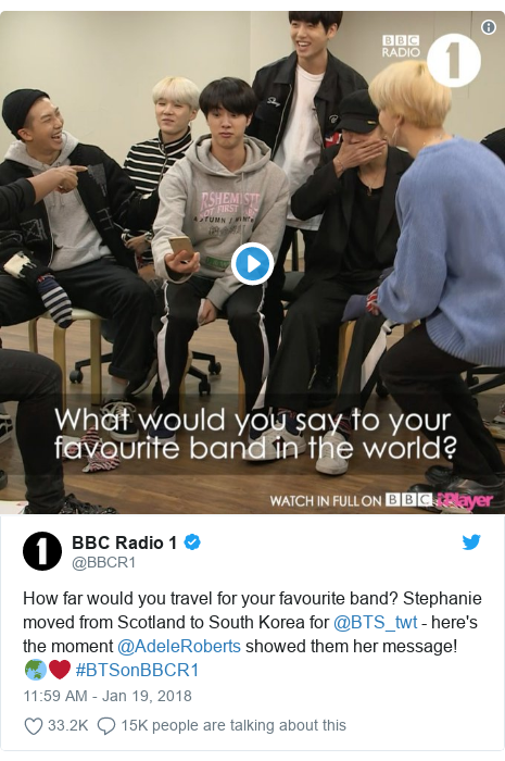 Twitter post by @BBCR1: How far would you travel for your favourite band? Stephanie moved from Scotland to South Korea for @BTS_twt - here's the moment @AdeleRoberts showed them her message! 🌏❤️ #BTSonBBCR1