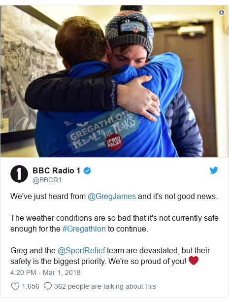 Twitter post by @BBCR1: We've just heard from @GregJames and it's not good news. The weather conditions are so bad that it's not currently safe enough for the #Gregathlon to continue.Greg and the @SportRelief team are devastated, but their safety is the biggest priority. We're so proud of you! ❤️