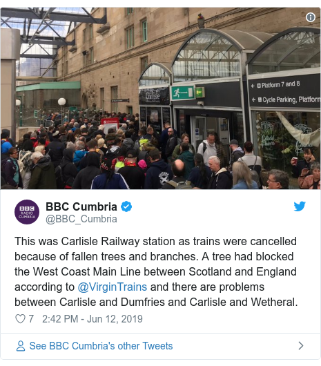 Twitter post by @BBC_Cumbria: This was Carlisle Railway station as trains were cancelled because of fallen trees and branches. A tree had blocked the West Coast Main Line between Scotland and England according to @VirginTrains and there are problems between Carlisle and Dumfries and Carlisle and Wetheral.