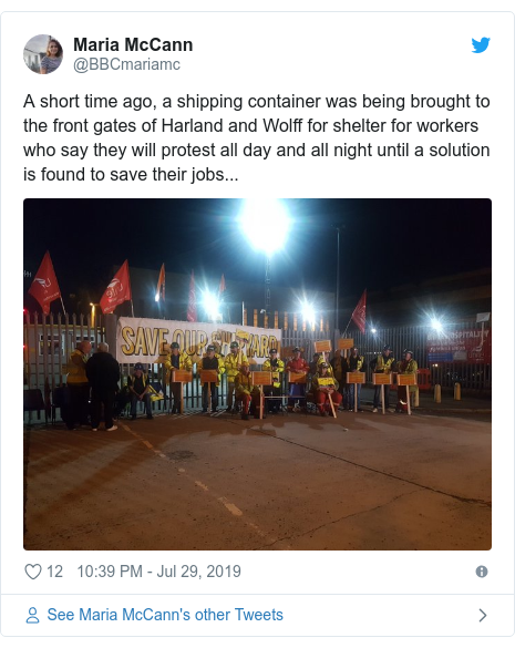 Twitter post by @BBCmariamc: A short time ago, a shipping container was being brought to the front gates of Harland and Wolff for shelter for workers who say they will protest all day and all night until a solution is found to save their jobs...