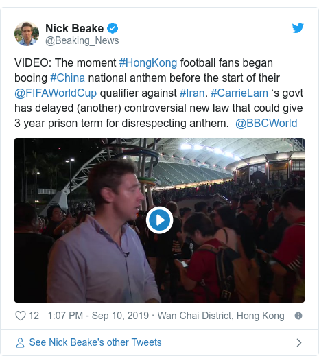 Twitter post by @Beaking_News: VIDEO  The moment #HongKong football fans began booing #China national anthem before the start of their @FIFAWorldCup qualifier against #Iran. #CarrieLam 's govt has delayed (another) controversial new law that could give 3 year prison term for disrespecting anthem.  @BBCWorld