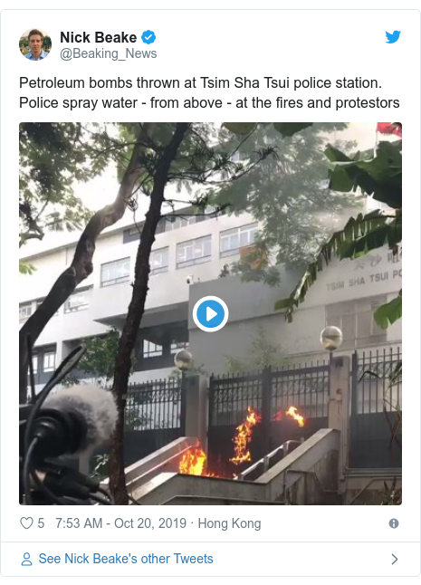 Twitter post by @Beaking_News: Petroleum bombs thrown at Tsim Sha Tsui police station. Police spray water - from above - at the fires and protestors