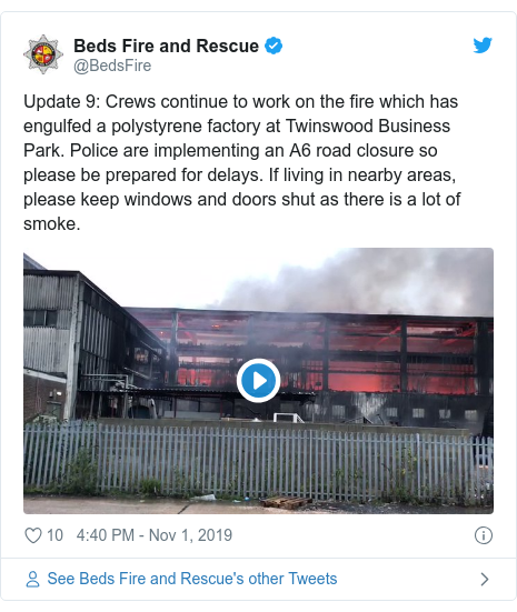 Twitter post by @BedsFire: Update 9  Crews continue to work on the fire which has engulfed a polystyrene factory at Twinswood Business Park. Police are implementing an A6 road closure so please be prepared for delays. If living in nearby areas, please keep windows and doors shut as there is a lot of smoke.