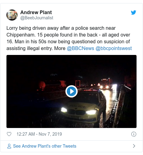 Twitter post by @BeebJournalist: Lorry being driven away after a police search near Chippenham. 15 people found in the back - all aged over 16. Man in his 50s now being questioned on suspicion of assisting illegal entry. More @BBCNews @bbcpointswest