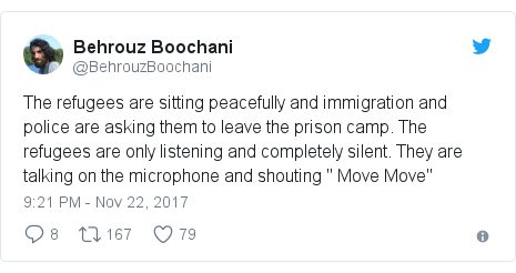 "Twitter post by @BehrouzBoochani: The refugees are sitting peacefully and immigration and police are asking them to leave the prison camp. The refugees are only listening and completely silent. They are talking on the microphone and shouting "" Move Move"""