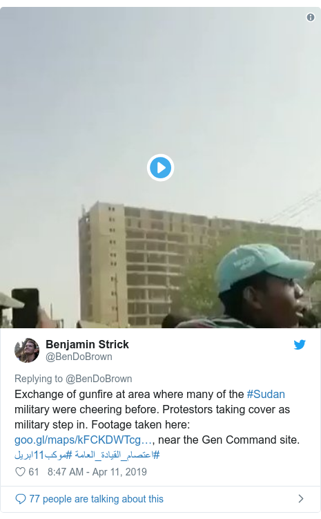 Twitter post by @BenDoBrown: Exchange of gunfire at area where many of the #Sudan military were cheering before. Protestors taking cover as military step in. Footage taken here  , near the Gen Command site. #موكب11ابريل #اعتصام_القيادة_العامة
