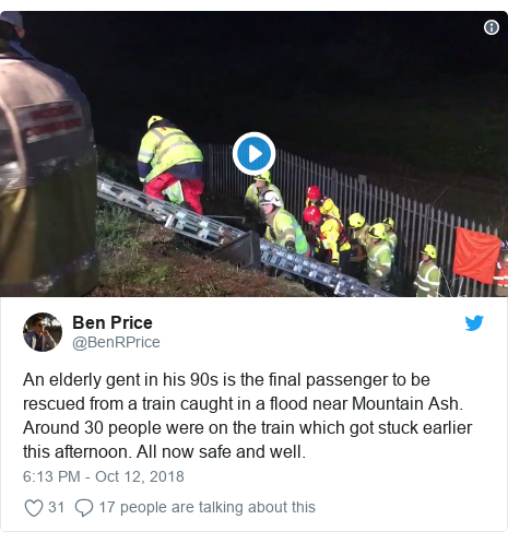 Twitter post by @BenRPrice: An elderly gent in his 90s is the final passenger to be rescued from a train caught in a flood near Mountain Ash. Around 30 people were on the train which got stuck earlier this afternoon. All now safe and well.