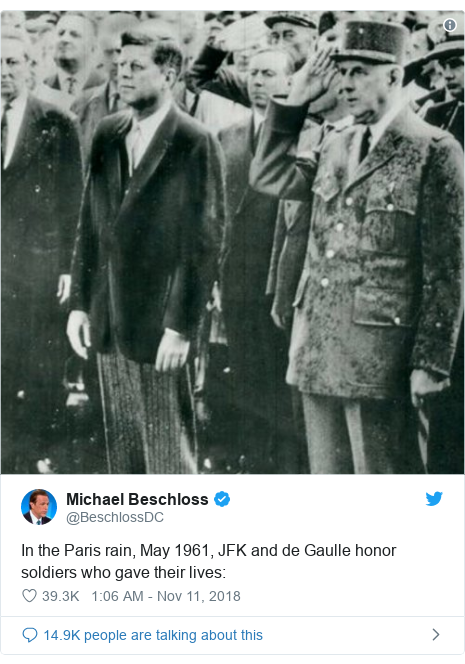 Twitter post by @BeschlossDC: In the Paris rain, May 1961, JFK and de Gaulle honor soldiers who gave their lives