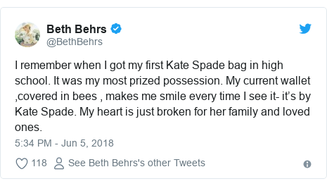 Twitter post by @BethBehrs: I remember when I got my first Kate Spade bag in high school. It was my most prized possession. My current wallet ,covered in bees , makes me smile every time I see it- it's by Kate Spade. My heart is just broken for her family and loved ones.