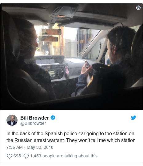 Twitter post by @Billbrowder: In the back of the Spanish police car going to the station on the Russian arrest warrant. They won't tell me which station