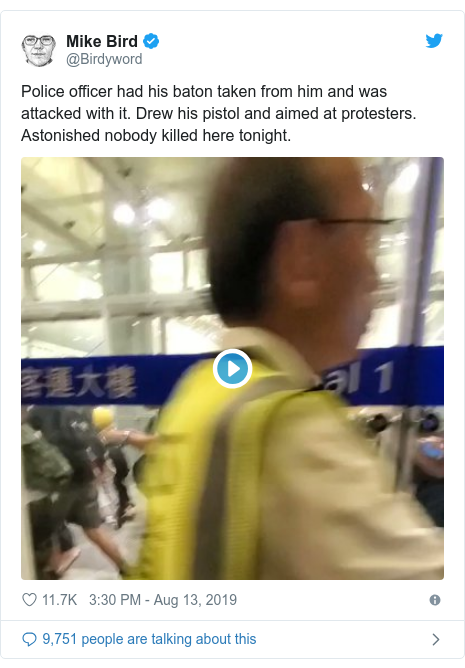 Twitter post by @Birdyword: Police officer had his baton taken from him and was attacked with it. Drew his pistol and aimed at protesters. Astonished nobody killed here tonight.