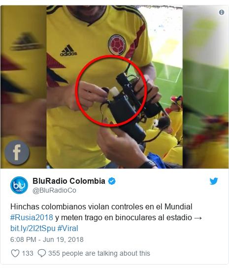 Twitter post by @BluRadioCo: Hinchas colombianos violan controles en el Mundial #Rusia2018 y meten trago en binoculares al estadio →  #Viral