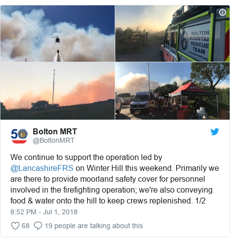 Twitter post by @BoltonMRT: We continue to support the operation led by @LancashireFRS on Winter Hill this weekend. Primarily we are there to provide moorland safety cover for personnel involved in the firefighting operation; we're also conveying food & water onto the hill to keep crews replenished. 1/2