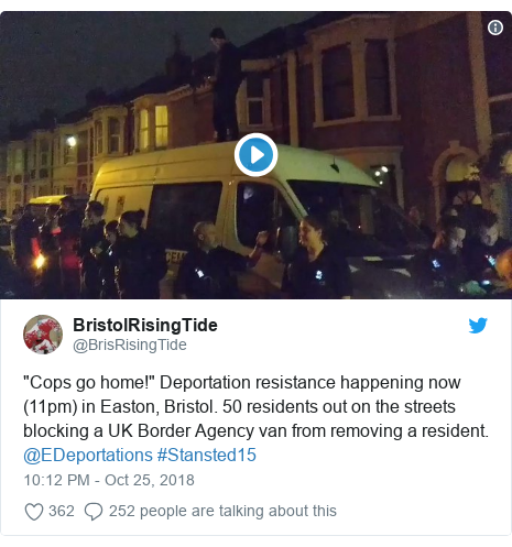 """Twitter post by @BrisRisingTide: """"Cops go home!"""" Deportation resistance happening now (11pm) in Easton, Bristol. 50 residents out on the streets blocking a UK Border Agency van from removing a resident. @EDeportations #Stansted15"""