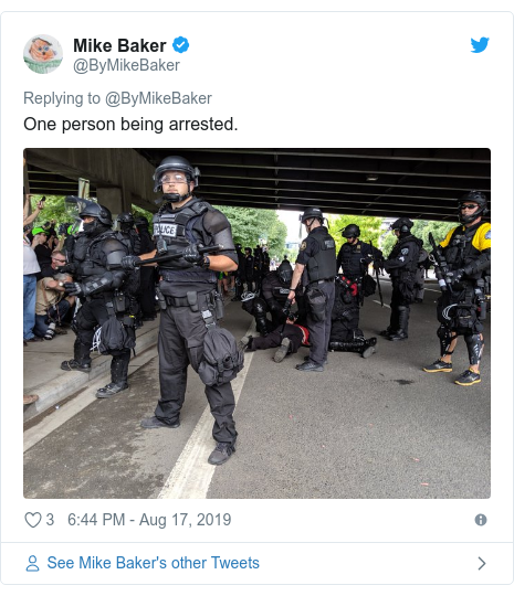 Twitter post by @ByMikeBaker: One person being arrested.