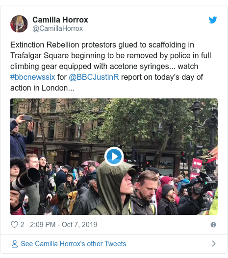 Twitter post by @CamillaHorrox: Extinction Rebellion protestors glued to scaffolding in Trafalgar Square beginning to be removed by police in full climbing gear equipped with acetone syringes... watch #bbcnewssix for @BBCJustinR report on today's day of action in London...