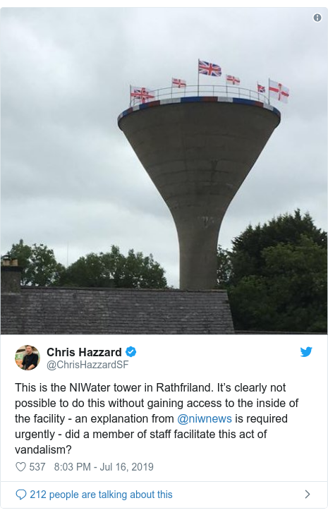 Twitter post by @ChrisHazzardSF: This is the NIWater tower in Rathfriland. It's clearly not possible to do this without gaining access to the inside of the facility - an explanation from @niwnews is required urgently - did a member of staff facilitate this act of vandalism?