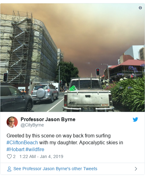 Twitter post by @CityByrne: Greeted by this scene on way back from surfing #CliftonBeach with my daughter. Apocalyptic skies in #Hobart #wildfire