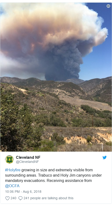 Twitter post by @ClevelandNF: #Holyfire growing in size and extremely visible from surrounding areas. Trabuco and Holy Jim canyons under mandatory evacuations. Receiving assistance from @OCFA