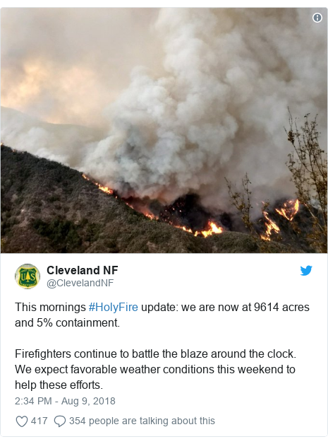 Twitter post by @ClevelandNF: This mornings #HolyFire update  we are now at 9614 acres and 5% containment. Firefighters continue to battle the blaze around the clock. We expect favorable weather conditions this weekend to help these efforts.