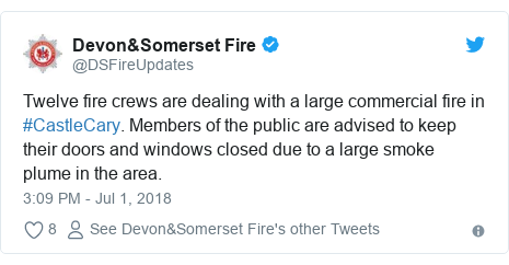 Twitter post by @DSFireUpdates: Twelve fire crews are dealing with a large commercial fire in #CastleCary. Members of the public are advised to keep their doors and windows closed due to a large smoke plume in the area.