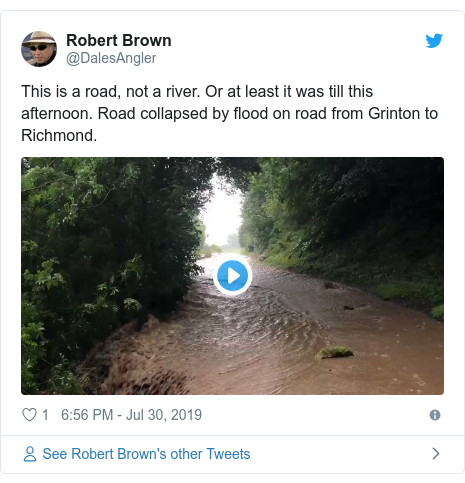 Twitter post by @DalesAngler: This is a road, not a river. Or at least it was till this afternoon. Road collapsed by flood on road from Grinton to Richmond.