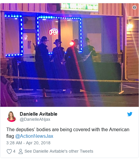 Twitter post by @DanielleANjax: The deputies' bodies are being covered with the American flag @ActionNewsJax