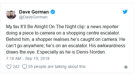 Twitter post by @DaveGorman: My fav It'll Be Alright On The Night clip  a news reporter doing a piece to camera on a shopping centre escalator. Behind him, a shopper realises he's caught on camera. He can't go anywhere; he's on an escalator. His awkwardness draws the eye. Especially as he is Denis Norden.