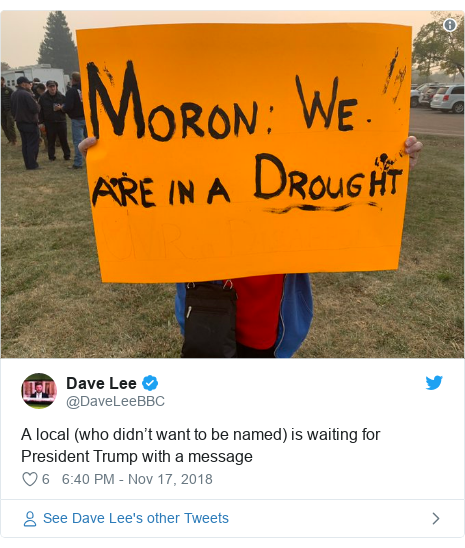 Twitter post by @DaveLeeBBC: A local (who didn't want to be named) is waiting for President Trump with a message