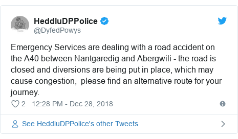 Twitter post by @DyfedPowys: Emergency Services are dealing with a road accident on the A40 between Nantgaredig and Abergwili - the road is closed and diversions are being put in place, which may cause congestion,  please find an alternative route for your journey.