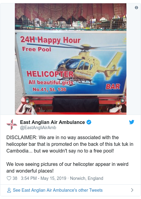 Twitter post by @EastAngliAirAmb: DISCLAIMER  We are in no way associated with the helicopter bar that is promoted on the back of this tuk tuk in Cambodia... but we wouldn't say no to a free pool! We love seeing pictures of our helicopter appear in weird and wonderful places!