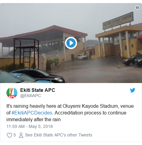 Twitter post by @EkitiAPC: It's raining heavily here at Oluyemi Kayode Stadium, venue of #EkitiAPCDecides. Accreditation process to continue immediately after the rain