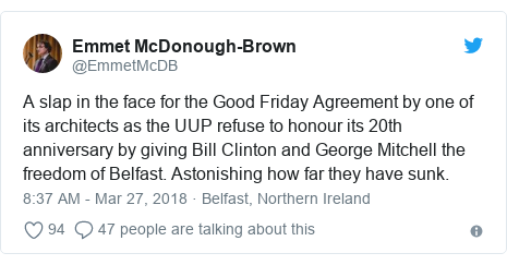 Twitter post by @EmmetMcDB: A slap in the face for the Good Friday Agreement by one of its architects as the UUP refuse to honour its 20th anniversary by giving Bill Clinton and George Mitchell the freedom of Belfast. Astonishing how far they have sunk.